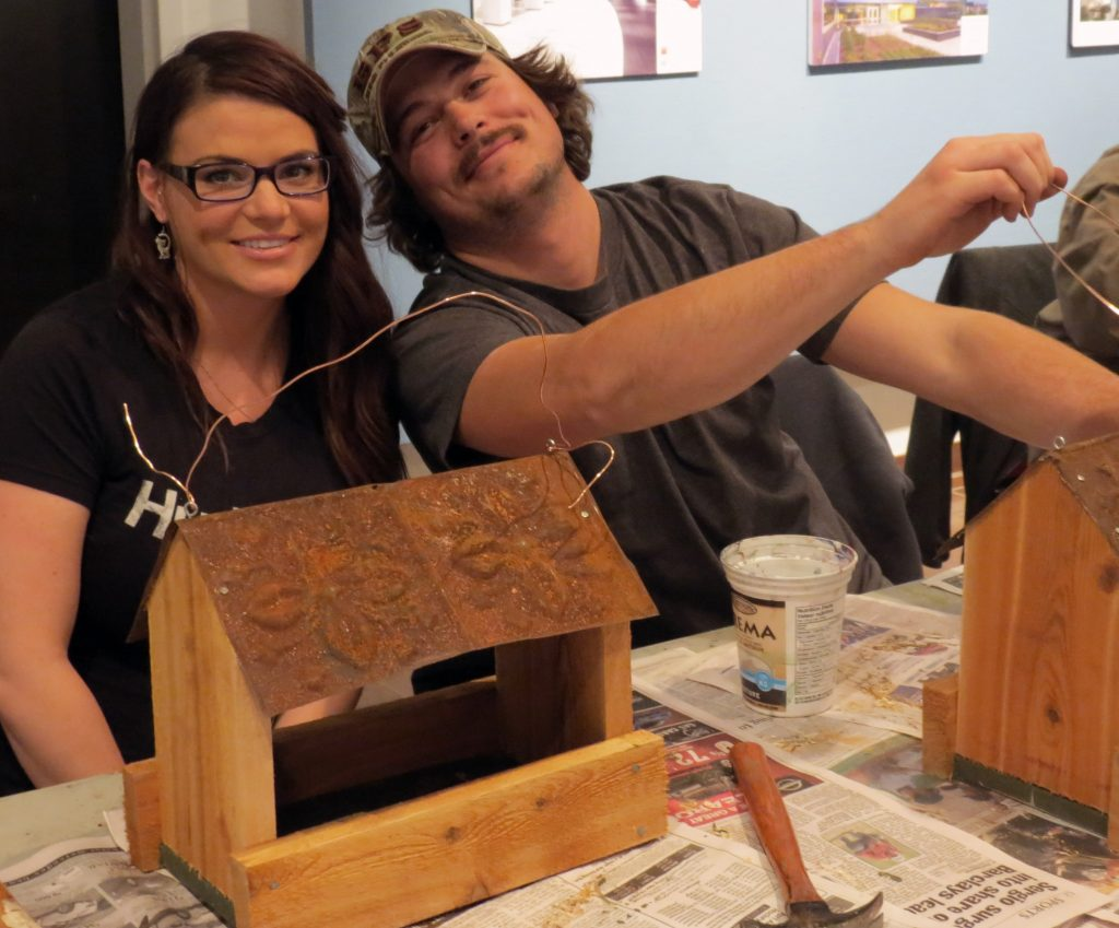 adults building birdhouses workshop